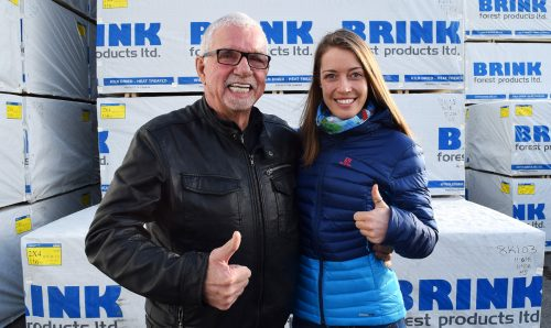 Biathlete Megan Tandy stopped by to thank one of her sponsors Friday, John Brink of the Brink Group of Companies. Bill Phillips photo