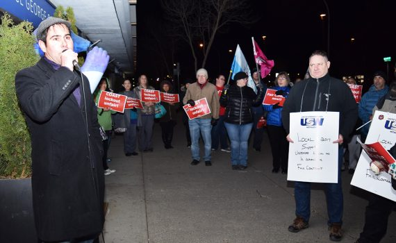 Harley Augustino, a negotiator for Unite Here Local 40, addresses a rally outside the Coast Inn of the North Wednesday evening. Unionized workers at the hotel have been served with a 72-hour lockout notice. Bill Phillips photo