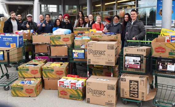 Eight local businesses chipped in $500 each to buy $4,000 worth of groceries for the St. Vincent de Paul and UNBC NUGSS food banks. Bill Phillips photo