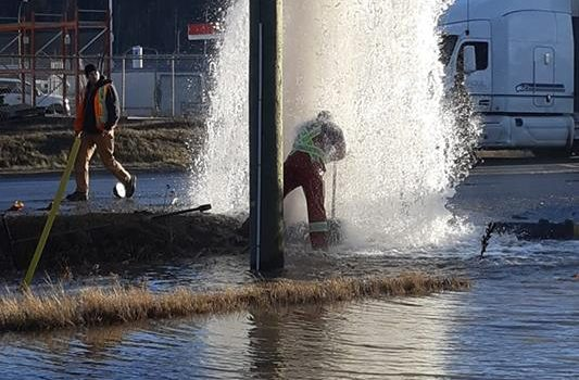 City employee Ryan Gallo battles a sheared-off fire hydrant. Ryan Lacasse Facebook photo