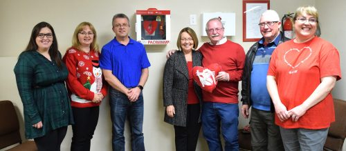 Team Bond gives automated external defibrillator to seniors group