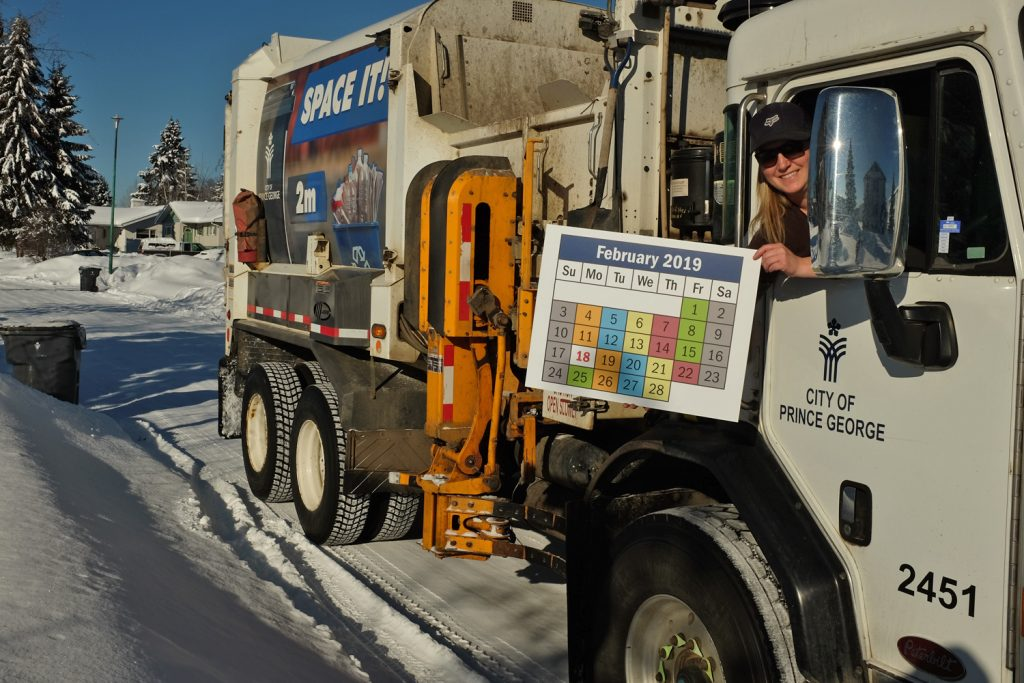 Leanne Wakely, a truck driver in the City's Solid Waste Services Division, displays the corrected February Garbage Collection Schedule. City of Prince George photo