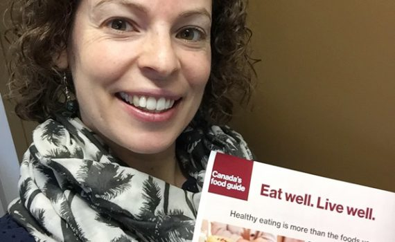 Lise Luppens, Population Health Dietitian, with Canada's new food guide. Northern Health photo