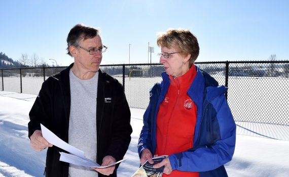 Ron Gallo goes over his registration forms for the 55 Plus B.C. Games with Linda Meise, Zone 9 director for the Games. Registration is now open for those wishing to compete in the Games this summer in Kelowna. Bill Phillips photo