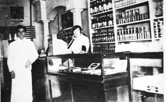 """""""Mr. and Mrs. Teddy Pappas in their store on George Street, 1918."""" Copyright The Exploration Place."""
