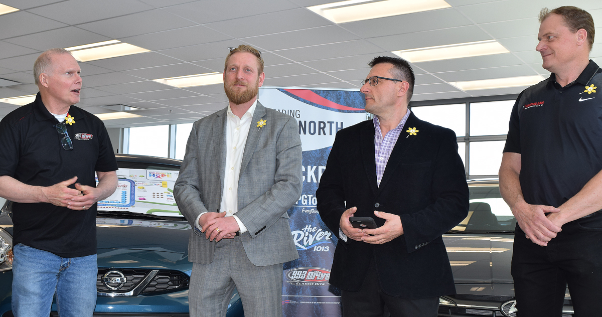 Doug Jones of the Canadian Cancer Society (left) joins Northland Dodge's dealers principal Jarred Kubbernus, Peter Sia, and Kyle Bachman in announcing the dealership will be giving away a car during this year's Relay for Life. Bill Phillips photo